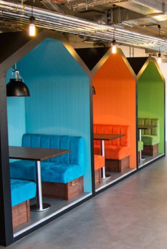 Blue, orange and green booths in a restaurant with roofs, showing our contract furniture