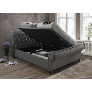 The Dublin Side Ottoman Bed in grey fabric. Lifestyle image of raised ottoman.