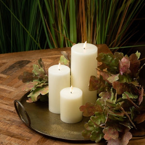 Luxe Collection LED Real Wax Ivory Candle [Medium] Lifestyle image.