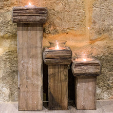 Load image into Gallery viewer, Set Of 3 Rustic Candle Holders. Image demonstrating the height of each candle holder.