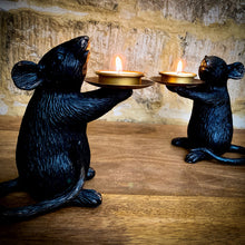Load image into Gallery viewer, A pair of Mice Candle Holders in black and gold. Lifestyle image.