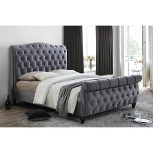 The Harrogate Bed. Upholstered in grey velvet. Lifestyle image.