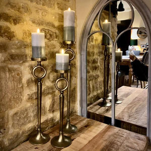 Antique Brass Candle Stands. Auburn Fox showroom image, Thrapston, Northamptonshire.