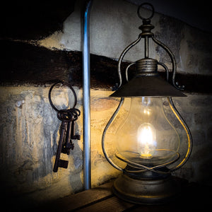 Battery Powered Industrial Glass Lantern. Lifestyle image.