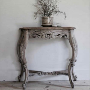 Carved Console Table made of mahogany in a vintage finish.