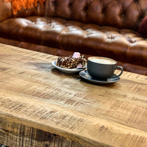 Industrial A-Frame Coffee Table close up lifestyle image.