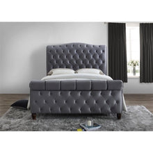 Load image into Gallery viewer, The Harrogate Bed. Upholstered in grey velvet. Lifestyle image view from the end.