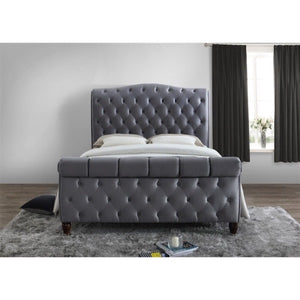 The Harrogate Bed. Upholstered in grey velvet. Lifestyle image view from the end.