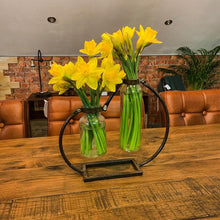 Load image into Gallery viewer, Lifestyle image of Industrial style double vase with an attractive metal frame. The vase has flowers.