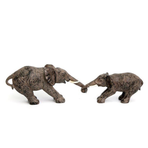 ornament depicting 2 Elephants playfully holding trunks in a tug of war.