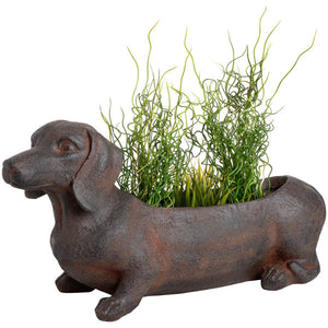 Delightful rustic sausage dog planter made of resin.