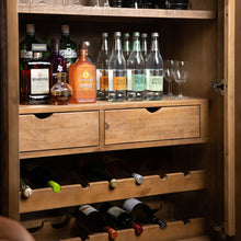 Load image into Gallery viewer, Savanna Gold Drinks Cabinet inside lifestyle image stacked with drinks and glasses.