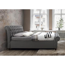 Load image into Gallery viewer, The Dublin Side Ottoman Bed in grey fabric. Lifestyle side view image