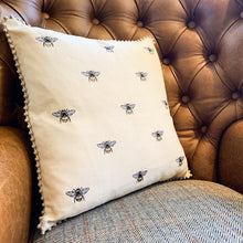 Load image into Gallery viewer, Embroidered Bee Cushion. Auburn Fox showroom image, Thrapston, Northamptonshire.