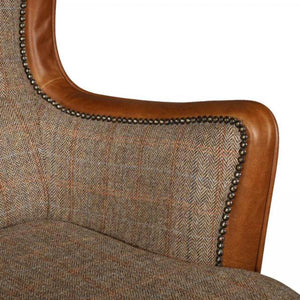 Elliot Two Seater sofa in Game keeper harris tweed and brown italian cerato leather. Close up of arm and stud work.