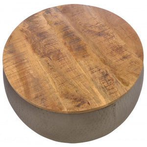 Industrial style round metal coffee table with rustic hardwood top.