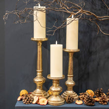 Load image into Gallery viewer, Luxe Collection LED Real Wax Ivory Candle [Large] lifestyle image on candle sticks.