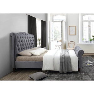 The Harrogate Bed. Upholstered in grey velvet. Lifestyle image view from the side.