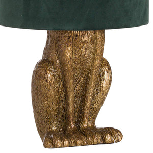 Gold Bunny Table Lamp With Green Velvet Shade. Close up image.