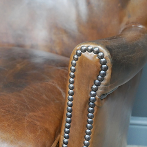 Leather Lounge Chair. Close up image of stud work on the arms.