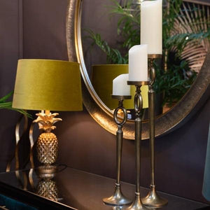 Antique Brass Candle Stands. Lifestyle image.