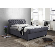 Load image into Gallery viewer, The Dublin Side Ottoman Bed in charcoal fabric. Lifestyle image.