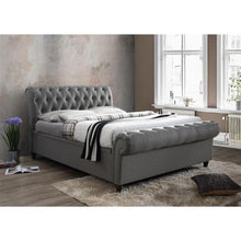 Load image into Gallery viewer, The Dublin Side Ottoman Bed in grey fabric. Lifestyle image.