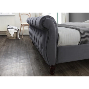 The Harrogate Bed. Upholstered in grey velvet. Lifestyle image. Close up image of foot-board upholstery.