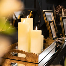 Load image into Gallery viewer, Luxe Collection LED Real Wax Ivory Candle [Small] Lifestyle image on a tray.