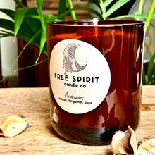Load image into Gallery viewer, Awakening by Free Spirit Candle Co. Premium candle exclusive to Auburn Fox. Orange, Bergamot & Sage Infused With Carnelian. Lifestyle image.