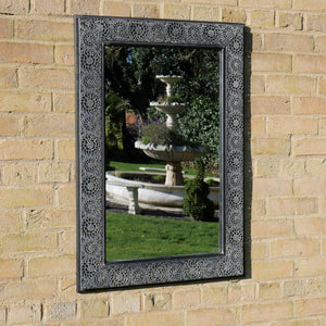 Outdoor Moroccan Garden Mirror with ornate metal frame. Lifestyle Image.