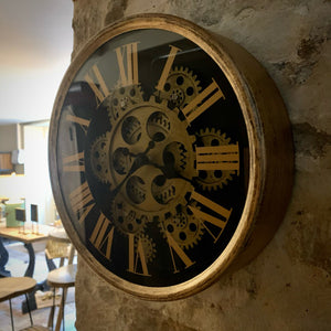 Small Gold Moving Gear Clock. Auburn Fox showroom image. Theapston, Northamptonshire.