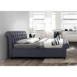 The Dublin Side Ottoman Bed in charcoal fabric. Lifestyle image. Side view of bed.