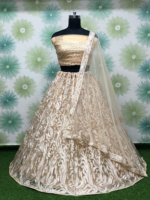 Chiku Color Anarkali Circular Heavy Net Embroidered Semi Stitched Lehenga Choli