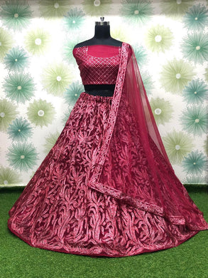 Maroon Color Anarkali Circular Heavy Net Embroidered Semi Stitched Lehenga Choli