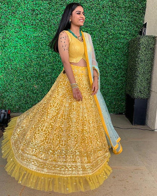 New Yellow Beutique Heavy Net Ruffle Border Embroidery Designer Lehenga Choli With Dupatta