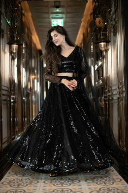 Party Wear Black Heavy Net Embroidered And Sequins Work Lehenga Choli