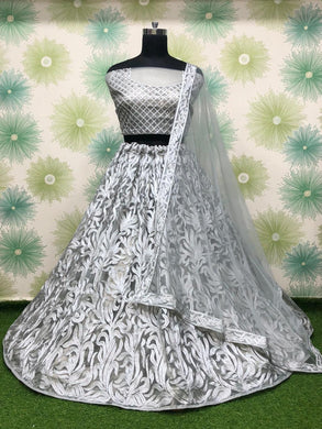 White Color Anarkali Circular Heavy Net Embroidered Semi Stitched Lehenga Choli
