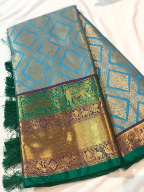 Blue Color Silk Woven With Zari Border Saree