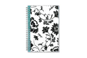2021 planner by blue sky featuring black flowers, white background, teal interior accents, and silver twin wire-o binding in 5x8 size