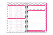 A 2020-2021 reference calendar on left page of a 5x8 planner and owner information and yearly goals on right side with magenta borders