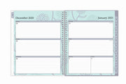 January 2021 - December 2021 weekly planner in 8.5x11 size with ample lined writing space Monday through Sunday and grey monthly tabs