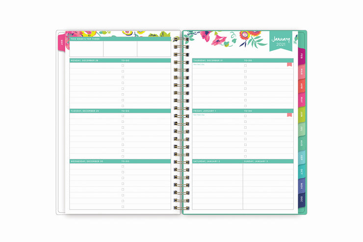 January 2021 weekly monthly planner featuring a weekly view, lined writing space, to do lists, priorities, and rainbow colored monthly tabs on a 5x8 planner