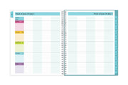 teacher lesson planner weekly spread with columns for school subject, rows for days of the month