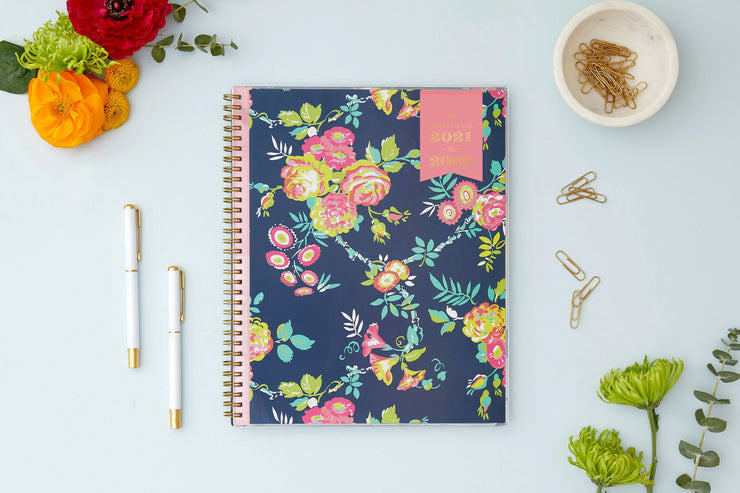 2021-2022 weekly monthly academic planner from Day Designer for Blue Sky featuring a navy background and floral front cover 8.5x11