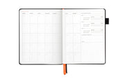 non-dated monthly page view, personalized your calendar, goal tracking, priority and notes section