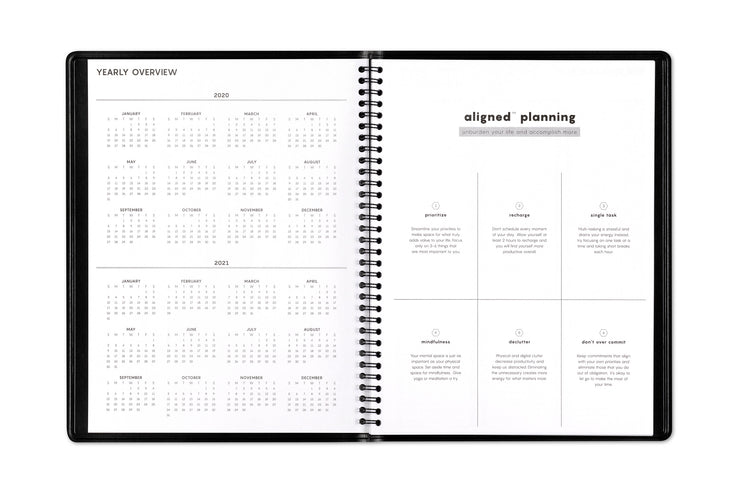 Aligned appointment book by Blue Sky featuring a yearly overview for 2020-2021 with guided steps for accomplishment