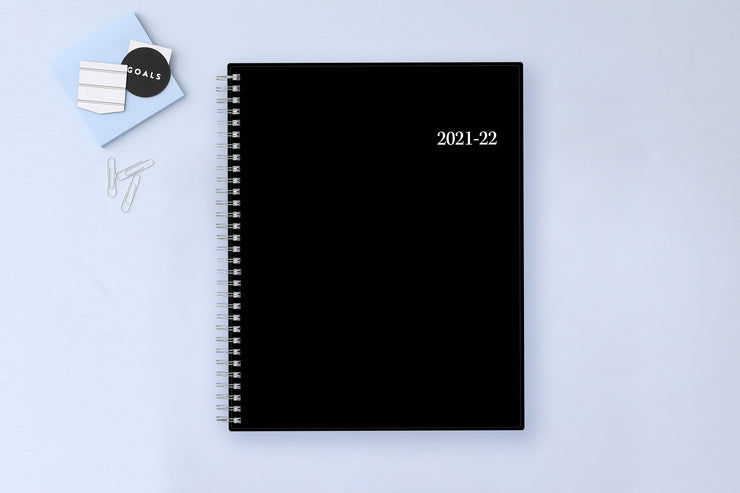 2021-2022 monthly academic professional planner featuring a solid black cover and silver twin wire-o binding in 8.5x11
