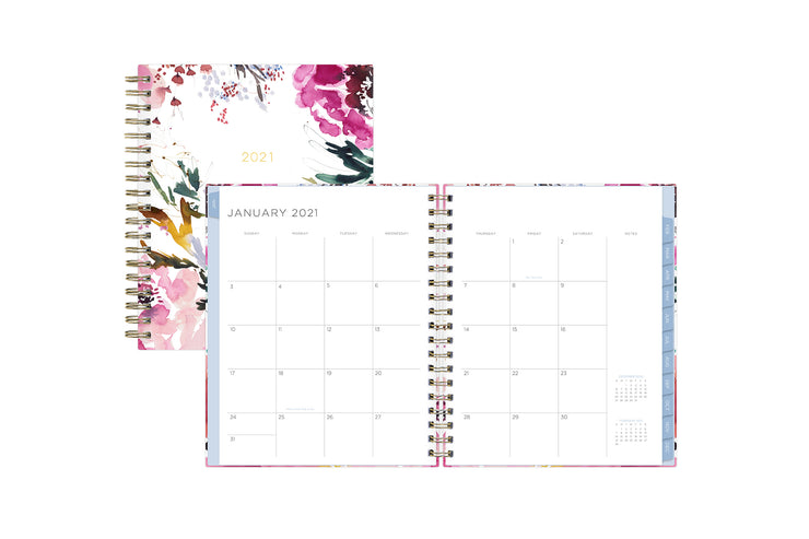 2021 floral planner featuring a monthly spread with lined boxes for each date and light blue monthly tabs january 2021 to december 2021