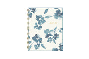 July 2021 - June 2022 academic weekly monthly planner featuring a white background and blue paint brush florals, twin wire-o binding in a 8.5x11 planner size for the school year